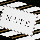 Nate: black and gold bell-press with custom belly band graphic Bar Mitzvah invitation