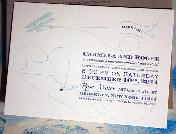 Carmela and Roger: Come Fly with Me, digitally printed in navy and turquoise with gravel envelope