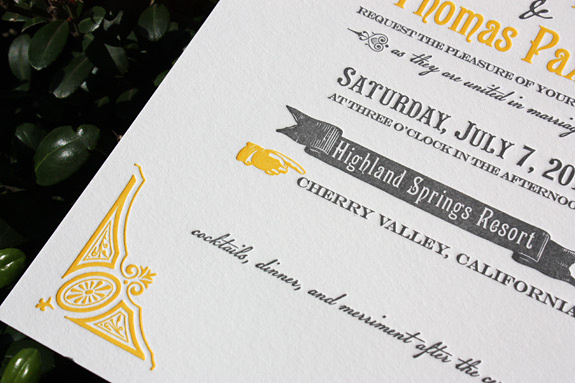Washington Square Letterpress wedding invitation shown in squash and charcoal.