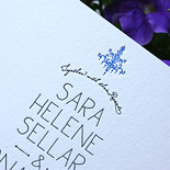Sara and Jonathan: cornflower and black letterpress with a chandelier motif and vintage flourish liner