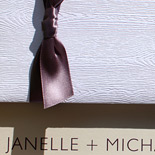 Janelle and Michael: white woodgrain pocketfold with earth cardstock and chocolate thermography