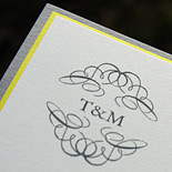 Tahima and Miraj: simple and elegant invitation in smoke thermography on ivory card stock layered with smoke and a pop of yellow