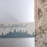 Kimberly and Jacob: vintage New York inspired, metallic pocket folder in matte metallic palette of golds and silvers with vintage New York map liner, letterpressed New York skyline