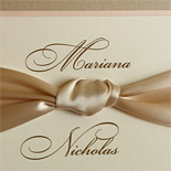 Mariana and Nicholas: traditiional wedding invitation suite with double backer, ribbon, thermography printed in gold with cream and champagne tones