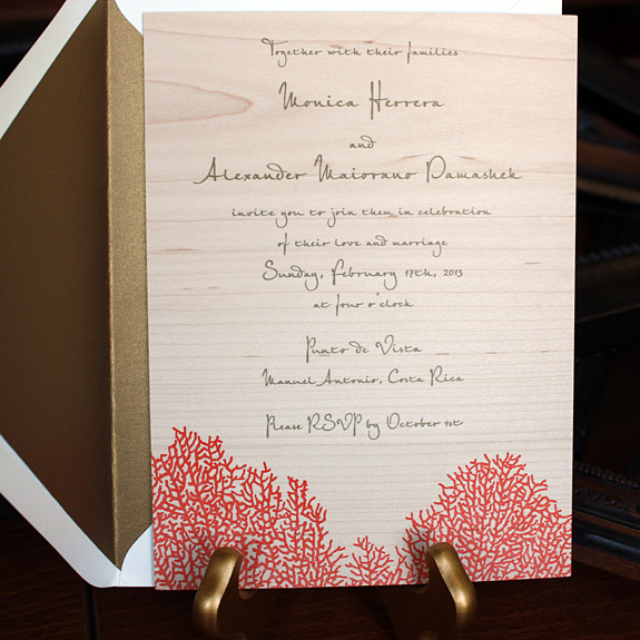 Monica and Alexander: invitation featuring coral design on wood with gold liner