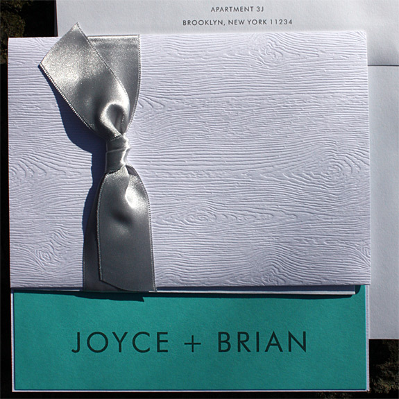 Joyce and Brian: thermography printed with pocket folder and silver band with wood grain texture