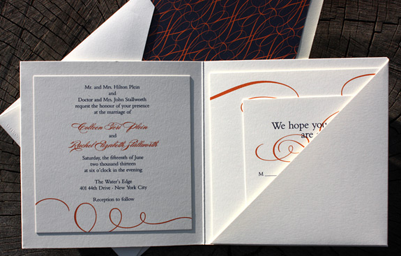 Colleen and Rachel: custom trifold pocket invitation printed in thermography and offset, tangerine and navy theme with bold swirls, custom corresponding liner
