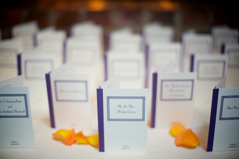A close-up of the escort cards, designed to look like tiny books.