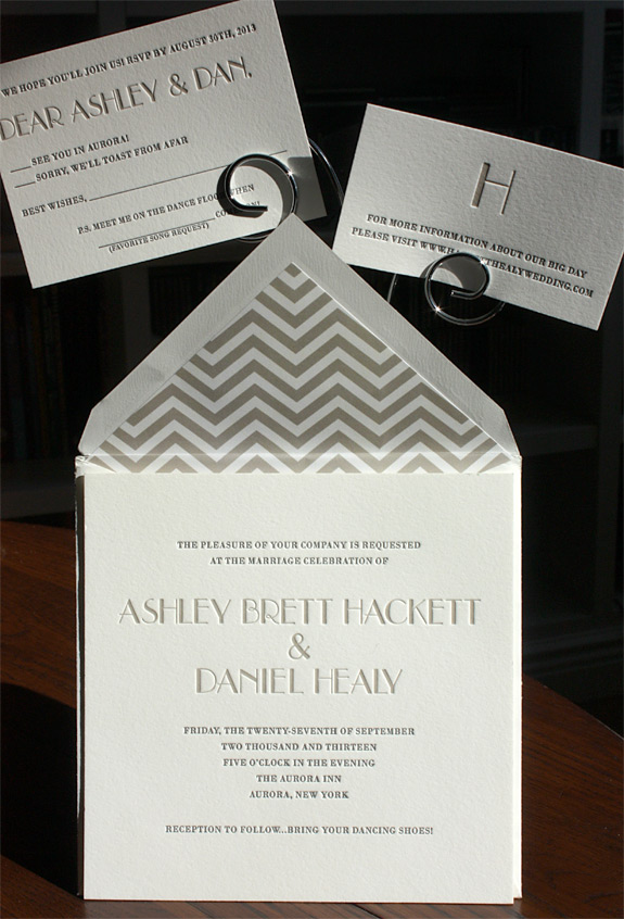 Ashley and Daniel:  art deco font in taupe on a pearl white paper with chevron envelope liner