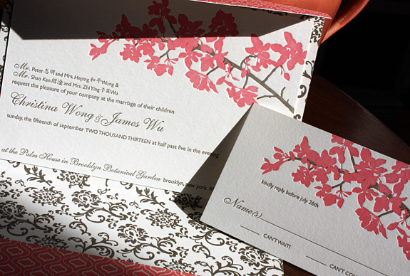 Christina and James: cherry blossoms appropriately grace this lovely letterpressed pocket fold invitation for a Brooklyn Botanical Garden wedding