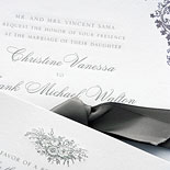 Christine and Frank: Save the Date and Wedding Invitation Suite featuring custom illustrations. Two color engraving and letterpress finished with a satin purple ribbon.