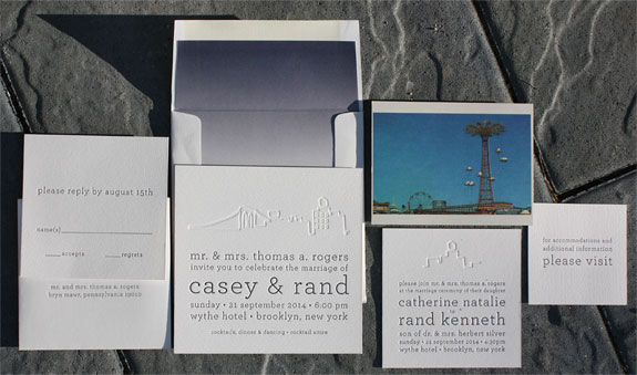 A Coney Island Save the Date Postcard was the jumping off point for this modern and subtle Brooklyn inspired wedding suite. Postscript Brooklyn designs are shown blind pressed with navy letterpresed text. The envelope features a navy ombre  liner.