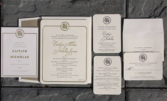 Caitlyn and Nicholas: Gorgeous gold foil and navy letterpress wedding suite featuring a custom monogram designed in-house by one of our illustrators. All topped off with rounded corners and a gold liner. Shown with gold foil save the date.