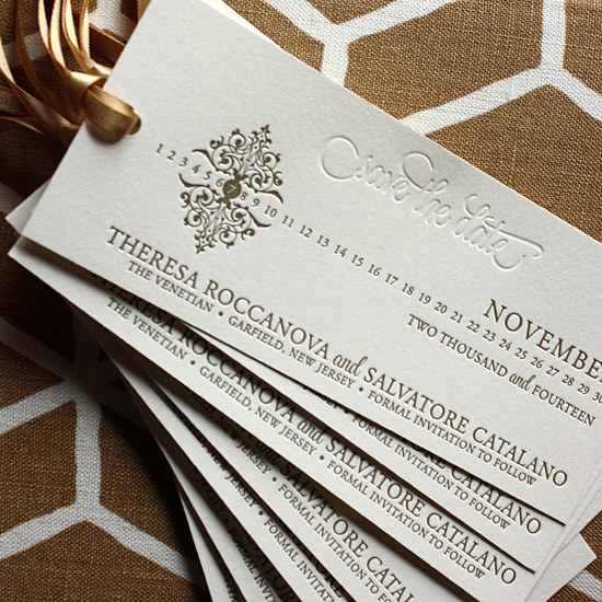 Theresa and Salvatore: Letterpressed, Save the Date Bookmark. Matte gold and blind pressed with a gold ribbon tassel.
