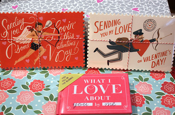 Packs of Valentine's Day postcards and What I Love About You by Me fill in the blanks book