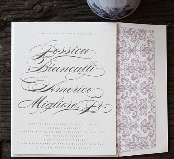 Jessica and Americo: Silver and lavender supersize names - it's all about the bride & groom! This invitation is incredibly romantic, emphasizing the couple's names in a gorgeous calligraphy and silver foil while adding touches of lavender with a damask patterned envelope liner.