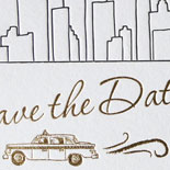Angela and Mike: save the date featuring a NYC skyline and classic taxi custom illustration letterpressed in black ink with gold foil