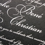 Brooke and Christian: a new take on the classic black and white wedding invitation with white foil on black stock