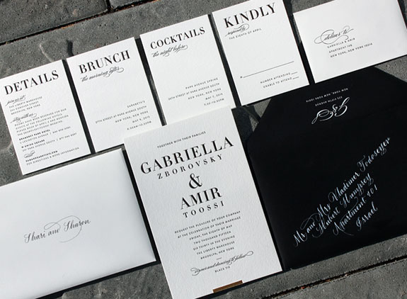 Gabriella and Amir: a modern, urban wedding invitation suite featuring black letterpress with a gold foil bar and white ink hand calligraphy