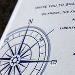 Kimberly and Aaron: nautical pocket folder wedding invitation suite featuring vintage map and compass