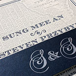 MeeMee and Steven: a soup to nuts New York map wedding suite incuding a custom foil stamped belly band, custom map, letterpressed invitation, digitally printed table numbers, place cards, favor tags and a magnet save the date