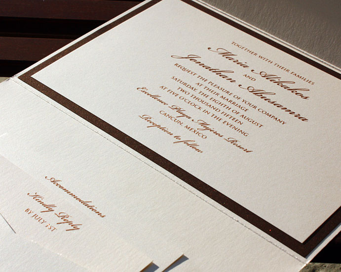 Maria and Jonathan: wedding invitation with map on pocket folder, sepia toned, monogrammed tag and layered invitation