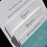 Kelly and Matthew: letterpressed invitation with rounded corners, turquoise edge painting and hand-calligraphed belly band