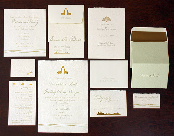 Natalie and Randy: custom illustrations of seals, trees and the NYC skyline in gold foil and letterpress on deckle edged paper weave throughout this Central Park Zoo wedding invitation
