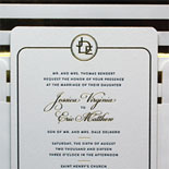 Jessica and Eric: bold foil gold bars on the liner, a repeated encircled monogram and rounded corners add up to a stunning wedding invitation