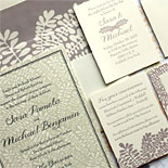 Sara and Michael - floral patterns beautifully play off each other on this romantic wedding invitation. Design by Bella Figura.