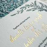 Danielle and Justin - A truly lovely combination of letterpress and gold foil with branches framing the pieces and a garden liner