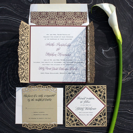 Anthi and Stephen - A pattern rich laser cut invitation on layered metallic card stock with dramatic gatefold