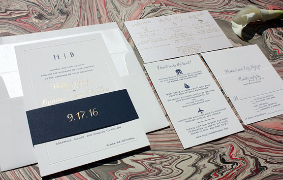 Holly and Brendan - A modern take on a classic presentation with gold foil, gold thermography, navy lettterpress and an embossed frame on the invitation