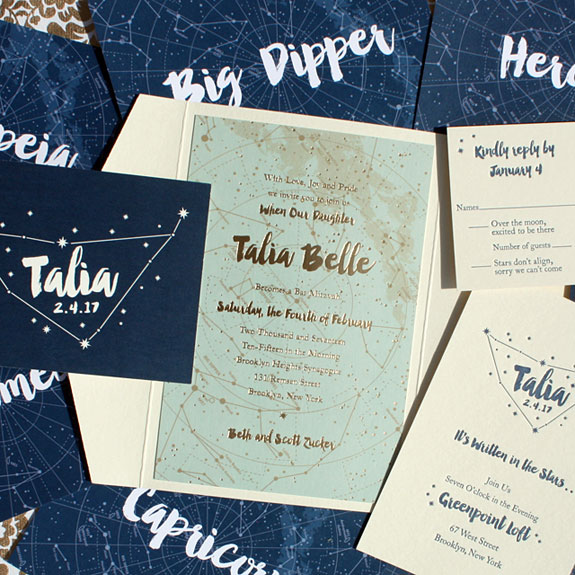 Talia - Gold foil and digital printing make for a stellar combination on this Bat Mitzvah invitation.  Other highlights include the constellation pocket fold and table name cards.