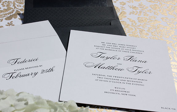 Taylor and Matthew - Classic black and white never goes out of style.  Black thermography ink with a black painted edge and a black pattern on black envelope liner