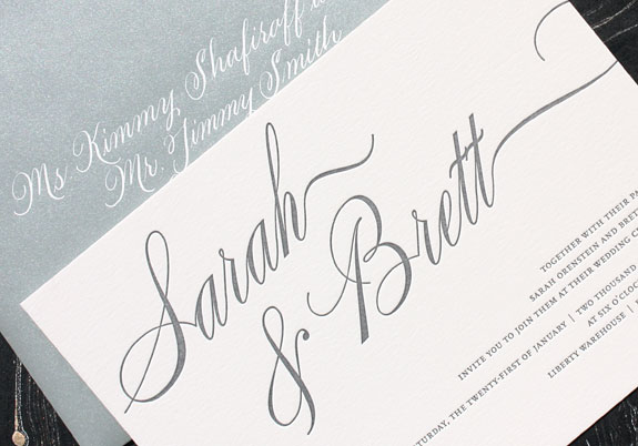 Sarah and brett love the bold silver calligraphic font